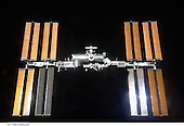 In Earth Orbit - March 25, 2009 -- Backdropped by the blackness of space, the International Space Station is seen from Space Shuttle Discovery as the two spacecraft begin their relative separation. Earlier the STS-119 and Expedition 18 crews concluded 9 days, 20 hours and 10 minutes of cooperative work onboard the shuttle and station. Undocking of the two spacecraft occurred at 2:53 p.m. (CDT) on March 25, 2009..Credit: NASA via CNP