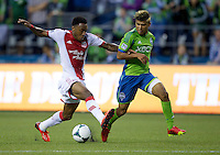 Rodney Wallace, left, of the Portland Timbers battles for the DeAndre Yedlin of the Seattle Sounders FC during play at CenturyLink Field in Seattle Saturday August, 3, 2013. The Sounder won the match 1-0.