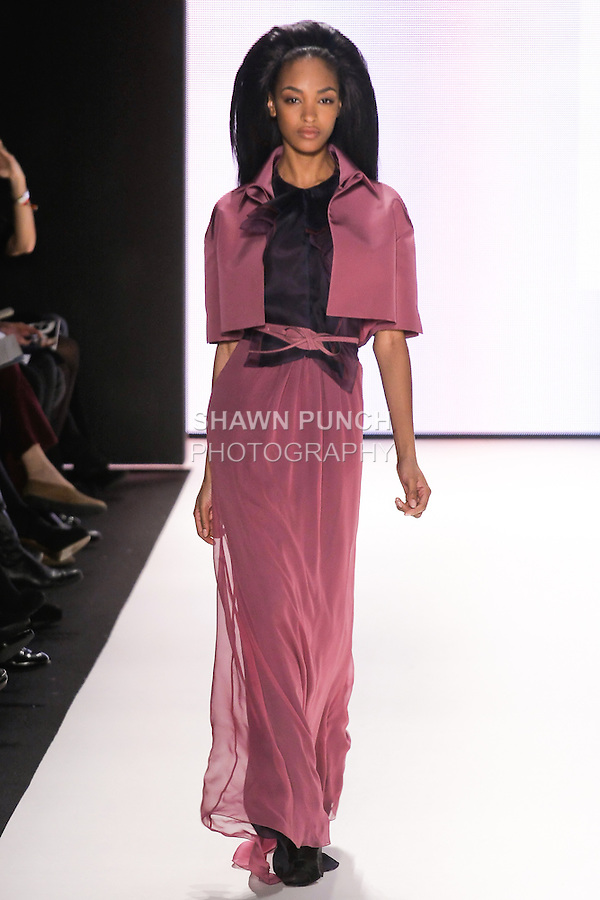 Jourdan Dunn walks runway in a modern mulberry layered silk chiffon gown, modern mulberry silk faille cropped jacket, modern mulberry silk faille belt, from the Carolina Herrera Fall 2012 collection, during Mercedes-Benz Fashion Week Fall 2012 in New York.