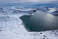 Winter view over snow covered Haukland and Vik beaches from summit of Mannen, Vestvågøy, Lofoten Islands, Norway