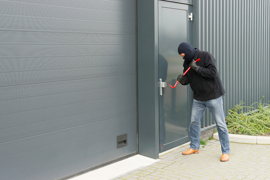 burglar in disguise to open an industrial door with brute force