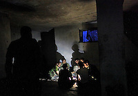 Members of the Afghan National Army have dinner before going out on patrol in Afghanistan's volatile Kunar province...(PHOTO: Javier Manzano). ..