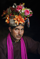 Man wearing flowers, Dha-Hanu, Ladakh, India, 2006