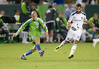 CARSON, CA – NOVEMBER 7:  Seattle Sounders midfielder Osvaldo Alonso (6) and LA Galaxy midfielder Juninho (19) during a soccer match at the Home Depot Center, November 7, 2010 in Carson, California. Final score LA Galaxy 2, Seattle Sounders 1.