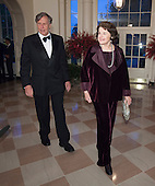 Dianne Feinstein, U.S.Senator and Richard Blum arrive at the State Dinner for China's President President Xi and Madame Peng Liyuan at the White House in Washington, DC for an official State Visit Friday, September 25, 2015. Credit: Chris Kleponis / CNP