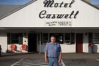 A portrait of Motel Caswell owner Russell Caswell outside the motel in Tewksbury, Massachusetts, USA, on Tuesday, Oct. 11, 2011. Caswell's father built the motel in the 1950s. Now, conservative activitists are trying to use federal asset-forfeiture laws to seize the motel, saying that the motel is used by drug dealers to conduct business.  The legal challenge intends to show evidence tying the property to crimes in order to seize the motel....CREDIT: M. Scott Brauer for the Wall Street Journal.slug: FORFEIT