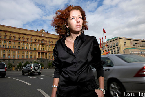 Portrait of human rights activist Tanya Lokshina in front of the Lubyanka, the headquarters of the Federal Security Service (formerly the KGB) in Moscow. .Lokshina is a researcher for the international organisation Human Rights Watch and she specialises in Chechnya..The Lubyanka building, where the KGB had imprisoned, interrogated and tortured many dissendents, continues to be a potent symbol of oppression in Russia.