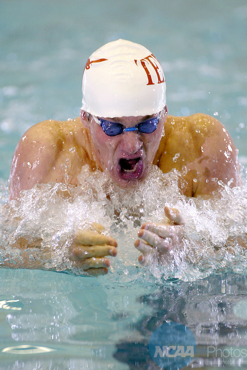 28 MAR 2004: Brendan Hansen of the University of Texas swims his way to a first place in the Men's 200M Breaststroke at the NCAA Division I Men's Swimming and Diving Championships at the Nassau County Aquatic Center in East Meadow, NY. Hansen placed first in the event to win the national title. Jeff Zelevansky/NCAA Photos