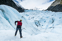 Glacier guide working on track on Fox Glacier, Westland National Park, West Coast, World Heritage Area, New Zealand