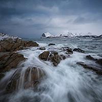 Rocky coastline of Flakstadøy overlooking Nappstraumen, Lofoten Islands, Norway