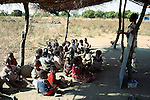 RImages MPHANDULA, MALAWI - AUGUST 21: Emma Adam, a teacher, teaches about fifty orphans under a thatched roof on August 21, 2006 in Mphandula village, about 30 miles outside Lilongwe, Malawi. Mphandula is a poor village in Malawi, without electricity or clean water. Nobody owns a car or a mobile phone. Most people live on farming. About 7000 people reside in the village and the chief estimates that there are about five-hundred orphans. Many have been affected by HIV/Aids and many of the children are orphaned. A foundation started by Madonna has decided to build an orphan center in the village through Consol Homes, a Malawi based organization. Raising Malawi is investing about 3 million dollars in the project and Madonna is scheduled to visit the village in October 2006. Malawi is a small landlocked country in Southern Africa without any natural resources. Many people are affected by the Aids epidemic. Malawi is one of the poorest countries in the world and has about 1 million orphaned children. (Photo by Per-Anders Pettersson)