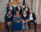 The five recipients of the 39th Annual Kennedy Center Honors pose for a group photo following a dinner hosted by United States Secretary of State John F. Kerry in their honor at the U.S. Department of State in Washington, D.C. on Saturday, December 3, 2016.  The 2016 honorees are: Argentine pianist Martha Argerich; rock band the Eagles; screen and stage actor Al Pacino; gospel and blues singer Mavis Staples; and musician James Taylor.  From left to right back row: Joe Walsh, Don Henley, and Timothy B. Schmidt of the rock band &quot;The Eagles.&quot; Front row, left to right: Al Pacino, Mavis Staples, Martha Argerich, and James Taylor.<br /> Credit: Ron Sachs / Pool via CNP