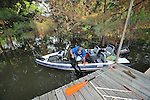"""8/11/11} Vicksburg} -- Vicksburg, MS, U.S.A. -- Mark Bridges,56, thrift store owner, pulls his dog """"baby girl"""" back into the boat after the dog jumped in thinking hshe was being left at the house when Mark was turning the boat around. Mark and his girlfriend of 12 years Patricia Clark, a HomeDepot garden employee, cruise down Chicksaw Rd in a bass boat in North Kings Community in Vicksburg Mississippi Wed. May 5th 2011. This is the firs time for Patricia to try and remove things from her trailer, that is built on 9ft stilts  AND THE WATER IS CURRENTLY AT 15 ft. and rising and is less than 12 inches from being flooded. Mark and Patricia have lived their all their lives and will return when the Mississippi River recedes,. ark has been helping his neighbors get their belongings to safety. Vicksburg a riverfront town steeped in war and sacrifice, gets set to battle an age-old companion: the Mississippi River. The city that fell to Ulysses S. Grant and the Union Army after a painful siege in 1863 is marshalling a modern flood-control arsenal to keep the swollen Mississippi from overwhelming its defenses. PHOTO©SUZIALTMAN.COM.Photo by Suzi Altman, Freelance."""