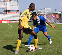 Andre Lewis (11) of Jamaica tries to get around Cristian Jimenez (6) of Guatemala during the group stage of the CONCACAF Men's Under 17 Championship at Catherine Hall Stadium in Montego Bay, Jamaica. Jamaica defeated Guatemala, 1-0.