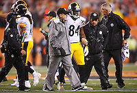 Antonio Brown #84 of the Pittsburgh Steelers walks off of the field after being hit by Vontaze Burfict #55 of the Cincinnati Bengals in the fourth quarter during the Wild Card playoff game at Paul Brown Stadium on January 9, 2016 in Cincinnati, Ohio. Brown would leave the game with a concussion. (Photo by Jared Wickerham/DKPittsburghSports)