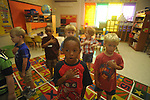 Kindergarten student Jamarian Wadley (foreground) recites the Pledge of Allegiance on the first day of school at Bramlett Elementary in Oxford, Miss. on Thursday, August 4, 2011.  (AP Photo/Oxford Eagle, Bruce Newman)