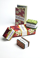February 6th 2013_Hong Kong, China_ Views of the Ai-Funan soap pack sold exclusively on Cathay Pacific which includes Lemongrass, Frangipani and Coffee flavors.  Ai-Funan (Timorese for Flower) soaps are handmade by a woman's co-operative in Timor-Leste and contain 100% all-natural ingredients: organic coconut and palm oils, aromatic botanical extracts and pure essential oils. All profits from the sale of Ai-Funan go back to support the women in Timor-Leste.Photographer: Daniel J. Groshong/The Hummingfish Foundation