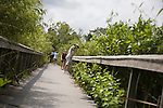 Visitors walk the area around the Shark Valley Visitor Center of the Everglades National Park in Florida.