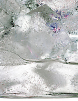 ICE MELTING IN A GLASS<br /> Water Freezes At 0 Deg C. Or 32 Deg F. At 1 Atm.