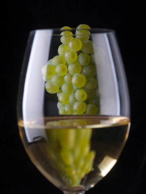Chardonnay grapes and glass