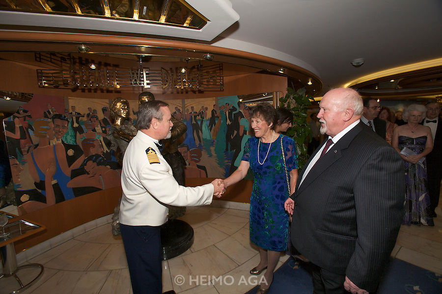 Aboard the Rhapsody of the Seas, on a cruise from Vancouver to Hawaii. Captain's Welcome Aboard Reception. Captain Rick Sullivan welcoming guests.