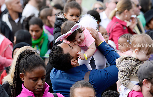 United States President Barack Obama kisses Stella Munoz at the White House Easter Egg Roll on the South Lawn of the White House March 28, 2016 in Washington, DC. <br /> Credit: Olivier Douliery / Pool via CNP