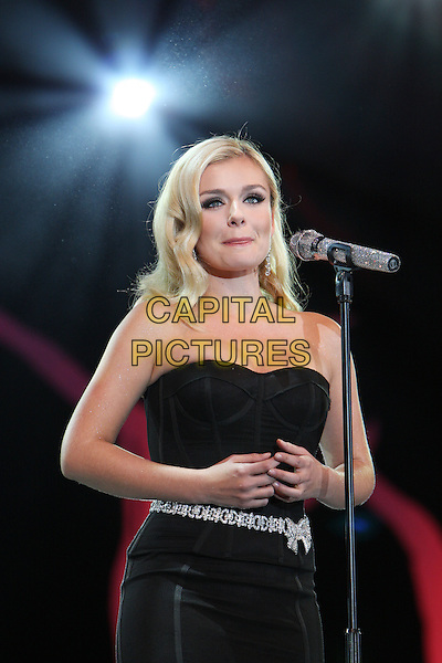 KATHERINE JENKINS .The BBC Proms In The Park at Hyde Park, London, England..September 12th, 2009.stage concert live gig performance music half length black strapless dress microphone tongue silver bow belt  .CAP/MAR.© Martin Harris/Capital Pictures.
