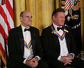 Singer James Taylor and Eagles band member Don Henley listen to United States President Barack Obama during a ceremony for 2016 Kennedy Center Honorees, in the East Room of the White House, December 4, 2016, Washington, DC. Other honorees include pianist Martha Argerich, actor Al Pacino, singer Mavis Staples and Eagles band members Timothy B. Schmit, and Joe Walsh. <br /> Credit: Aude Guerrucci / Pool via CNP