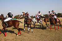 Players jostle for the ball during a game between the Royal Jaipur Polo Team (in pink) and the Western Australia Polo Team (in black) for the Argyle Pink Diamond Cup, organised as part of the 2013 Oz Fest in the Rajasthan Polo Club grounds in Jaipur, Rajasthan, India on 10th January 2013. Photo by Suzanne Lee