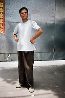 Zhushilong, a farmer, age 46, poses for a portrait in Nanjing. Response to 'What does China mean to you?': 'A peaceful society, flourishing abundance.'  Response to 'What is China's role in the future?': 'China is my most beloved relative!'