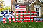 "Bellmore, New York, USA. November 2, 2016. Large letters spelling TRUMP, and many other colorful pro-Trump displays are in Halloween front yard display of Eileen Fuscaldo, a supporter of the Republican presidential candidate Donald Trump. On her front door is a life-size cardboard Trump holding ""The Silent Majority Stands with Trump"" sign."