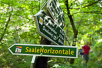 Thuriningia, East Germany, June 2010. From Lobeda we follow the trail to the Furstenbrunnen springs, and through the forest to the Hummelsberg and via the village of Ziegenhain we end up at the Restaurant next to the fuchsturm tower.  The 71 kilometer long Saale Horizontale hiking trail around the city of Jena follows the contours of the surrounding rocks. The former German Democratic Republic of East Germany is a haven of wild nature, with unspoiled and untouched old growth forests. Hiking and biking trails are everywhere. Photo by Frits Meyst/Adventure4ever.com