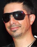 """Moenia pop music band member, Jorge Soto smiles as he talks to reporters during a press conference,in Mexico City March 28, 2006. Moenia received a golden award after selling 50 thousand copies of their last CD """"Hits Live"""". Photo by © Javier Rodriguez"""