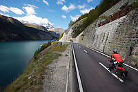 A touring cyclist and scenic lake - Switzerland