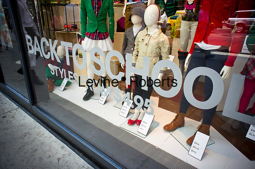 A back to school window display is seen at an H&M department store in New York on Thursday, August 2, 2012. Stores are beginning to offer earlier than usual back to school specials. (© Richard B. Levine)