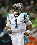 Carolina Panthers quarterback Cam Newton (1) runs onto the field to lead his team against the Seattle Seahawks at CenturyLink Field in Seattle, Washington on December 4, 2016.  Seahawks beat the Panthers 40-7.  ©2016. Jim Bryant photo. All Rights Reserved.