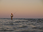 Don Baugh fishes in the shallows at Goose Island, VA at sunrise.