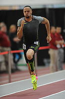NWA Democrat-Gazette/ANDY SHUPE<br /> Former Arkansas standout Wallace Spearmon competes in the 200-meter Olympic Development race Saturday, Feb. 11, 2017, during the Tyson Invitational in the Randal Tyson Track Center in Fayetteville. Visit nwadg.com/photos to see more photographs from the meet.