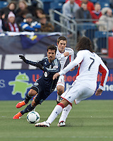Sporting Kansas City midfielder Benny Feilhaber (10) works to intercept a pass.  In a Major League Soccer (MLS) match, Sporting Kansas City (blue) tied the New England Revolution (white), 0-0, at Gillette Stadium on March 23, 2013.