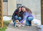 Wantagh, New York, USA. February 7, 2016. Mom SARI and daughter EMILY, volunteers from Merrick, pet Halley the white and orange beagle, who is available for adoption, as they take her for a walk during Last Hope Animal Rescue's Open House during Hallmark Channel Kitten Bowl III. The center's guests watched the feline football games on TV and cheered for their team, the Last Hope Lions. Over 100 adoptable kittens from Last Hope Inc and North Shore Animal League America participated in the games for the 2016 championship, which first aired the day of Super Bowl 50.
