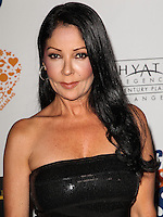CENTURY CITY, CA, USA - MAY 02: Apollonia Kotero at the 21st Annual Race To Erase MS Gala held at the Hyatt Regency Century Plaza on May 2, 2014 in Century City, California, United States. (Photo by Celebrity Monitor)