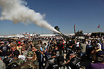 Howitzer blanks are fired in a 21 gun salute during opening ceremonies of the Kokomo Vietnam Veteran's Reunion. Vietnam Veterans gather in Kokomo, Indiana for the 2009 reunion.