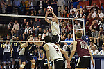 27 APR 2014: Keaton Pieper (12) of Springfield College sets against Juniata College during the Division III Men's Volleyball Championship held at the Kennedy Sports Center in Huntingdon, PA. Springfield defeated Juniata 3-0 to win the national title.  Mark Selders/NCAA Photos