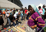 A Wixarica Native woman sells her handcrafts during the Wirikuta Fest in Mexico City's Foro Sol , May 26, 2012. The Wirikuta Fest was organized by music bands like Calle 13 and Cafe Tacuba to support the struggle of the Wixarica Native people to stop the trasnational mining corporations plans to destroy the sacred place of Wirikuta. Photo by Javier Rodriguez