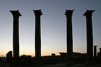 Sunset silhouette of 4 Corinthian columns, each 14m high, 1,20m circumference, Nymphaeum Temple, 2nd century AD, Bosra, Syria; used to supply water for irrigation as well as drinking water. Picture by Manuel Cohen
