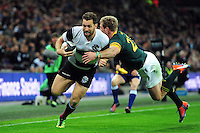 Luke Morahan of the Barbarians looks to fend Ruan Combrinck of South Africa. Killik Cup International match, between the Barbarians and South Africa on November 5, 2016 at Wembley Stadium in London, England. Photo by: Patrick Khachfe / JMP