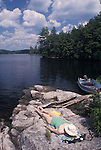 Woman Sunbathing on Rocks in Ontario Lake