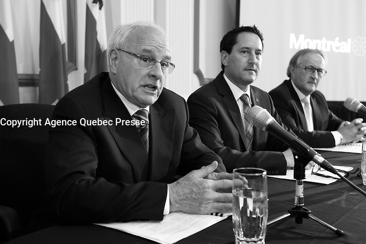 May 8, 2013 File Photo - Jacques Leonard (L) and Michael Applebaum, mayor of Montreal (R) adress the medias at the official deposition of Leonard's report on Municipal contracts.