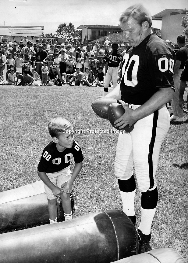 "Raider center Jim Otto with his son Jim Jr. during .""Family Day""at the Santa Rosa training site..(1971 photo/Ron Riesterer)"