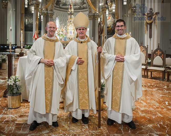 Apr. 26, 2014; Rev. Adam Booth, C.S.C., left, Bishop Kevin Rhoades, and Rev. Patrick Reidy, C.S.C. pose for a photo in the Basilica of the Sacred Heart after the 2014 Ordination Mass.<br /> <br /> Photo by Matt Cashore/University of Notre Dame